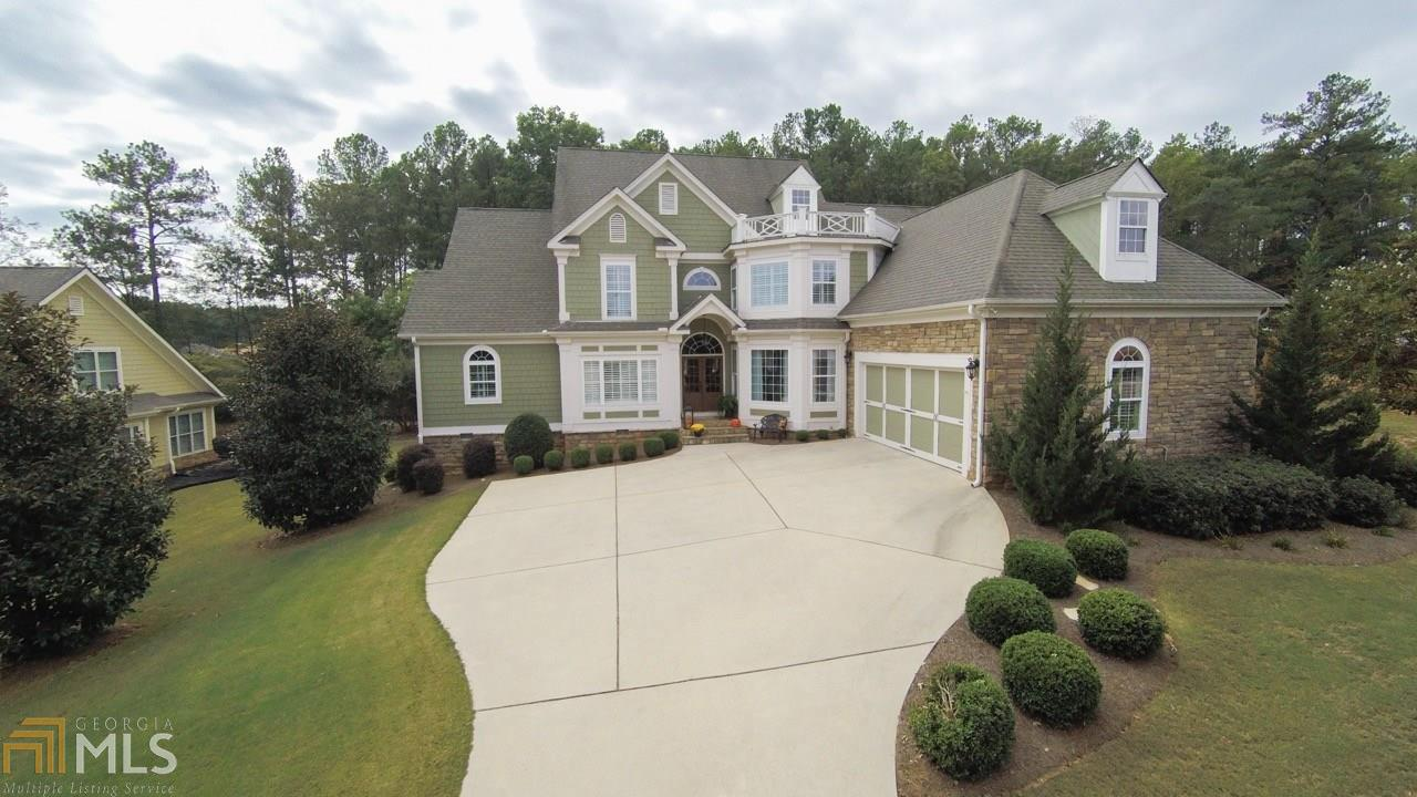 Coffered ceiling and stone fireplace vaulted keeping room with - Homes For Sale In Mcdonough Ga